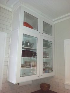 Glass front cabinets to ceiling, custom crown moulding