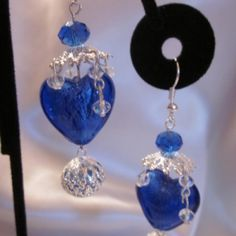 Blue heart dangeling earrings  at the Shopping Mall, $15.00