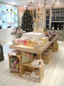 creative visual merchandising display on table - Google Search