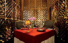 Indulge in a romantic, private dinner in Secret Maroma Beach's expansive wine cellar.