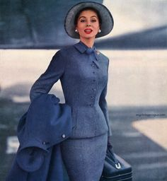 Suzy Parker wearing a suit by Finger  Rabiner, Inc. 1955
