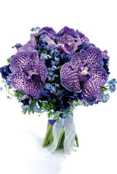 Hand-tied bouquet of vanda orchids, forget-me-nots and anemones, Pollen Nation (020 8987 8533). Photography: RGB Digital.