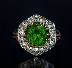 Rare 2.84 Carat Russian Demantoid Diamond Silver Gold Ring. A Rare Almost 3 Carat Russian Demantoid and Diamond Ring made between 1908 and 1917.  The silver topped 14K gold ring features a very large vivid grass green 2.84 ct Russian demantoid (8.55 x 5.45 mm) prong-set in gold within a hexagonal frame embellished with old cut diamonds (approximately 1.20 ct total weight). Marked with 56 zolotnik gold standard