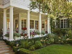 I. LOVE. THIS. PORCH! Along with the window boxes & landscaping, this has to be the prettiest porch I've ever seen!