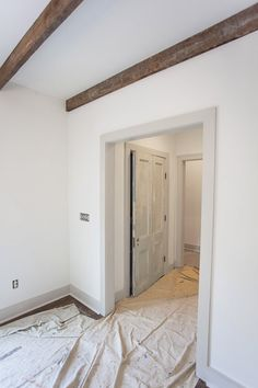 Rustic Beams - they are thin wood boards typically used on the floor turned sideways for ceiling beams | Revere Pewter Trim | White Dove Walls -- Ashley Gilbreath