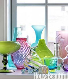 Glass collection glows on a windowsill
