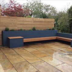 Raised beds planted with herbs. Hardwood bench and screening.