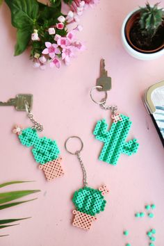 DIY gift: cactus keychain with Hama bow beads Perler Bead Designs, Hama Beads Design, Diy Perler Beads, Perler Bead Art, Hama Beads Coasters, Melty Bead Designs, Diy Perler Bead Keychain, Diy Perler Bead Crafts, Melted Bead Crafts