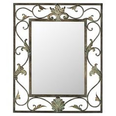 Scrolling iron wall mirror with a vine motif.   Product: MirrorConstruction Material: GlassColor: Antique brown and goldFeatures:  Transitional clean design with functionality and versatilityCharming designWill enhance any dcor  Dimensions: 27.6 H x 22.5 W