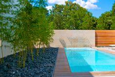 limestone wall, water spouts as part of pool, by hocker design