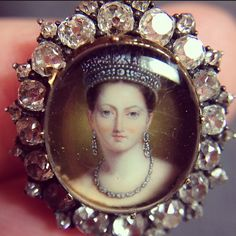 A wonderful little pendant with a portrait miniature of Queen Victoria set in an old cut diamond frame with her crowned monogram engraved on the reverse. She is tiny (as you can tell from the size of my fingers in the background!) but so beautifully painted with her pale skin, gentle blush and wonderful jewellery. She's up for sale @sothebys Bond Street on March 15th and I think she's perfectly lovely!
