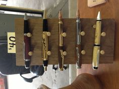 Handmade walnut pen display racks. Cost the same to make these vs having a plastic one.