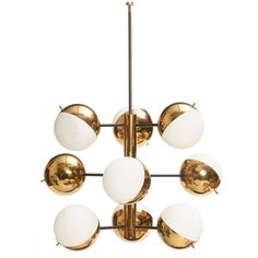 "843. Stilnovo hanging light fixture, made in Italy, nine-light chandelier of brass with original frosted white glass globes radiating from a central column and supported by black enameled metal rods, marked with Stilnovo label, 25""dia. x 35""h, needs to be wired, otherwise excellent condition 1500-2000"