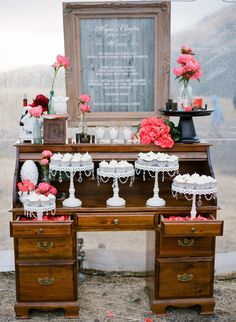 dessert table on old roll top desk, love how the drawers are pulled out to display cake stands