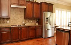 White trim with wood cabinets in kitchen