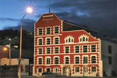 The Crown Roller Mills building in Dunedin, New Zealand was purpose built in 1867 to house a steam-driven flour mill. Looking impressive with all architectural details picked out. South Pacific, Pacific Ocean, Dunedin New Zealand, Long White Cloud, Flour Mill, New Zealand South Island, State Of Arizona, Spelling And Grammar, New Zealand Travel