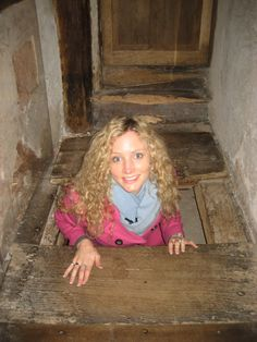 Catholic priests were persecuted by law in England from the beginning of the reign of Queen Elizabeth I in 1558. In this still from our Bloody Tales of the Tower DVD, tudor historian Dr Suzannah Lipscomb is in a 'priest hole', a hiding space where catholic priests used to conceal themselves if ever pursuivants came looking for them.