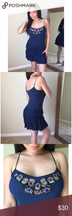 Free People Gem Summer Dress💙👗☀️ Free People Gem Summer Dress💙👗☀️ Size Medium, worn twice for summer, dress has no stains and no tears. Dress features adjustable straps, Ruffles, waist tie and beautiful front gems/ stones. Dress has one small flaw of a blue gem that's broken (see 3rd pic) dress is perfect for summer to pair with your fav sandals or heels! All things from my closet come from a smoke free home😊💙👗 Free People Dresses Mini