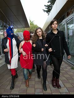 Sochi, Russia. 20th Feb, 2014. Nadezhda Tolokonnikova (R), Maria Alyokhina (2-R) and two masked activists of the punk group Pussy Riot leave following a news conference held outside a hotel in Sochi, Russia Photo: Christian Charisius/dpa/Alamy Live News