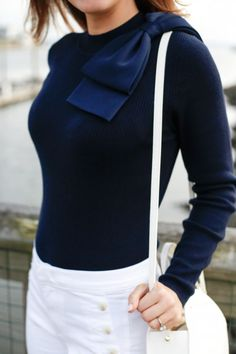 Navy bow sweater + white sailor jeans.