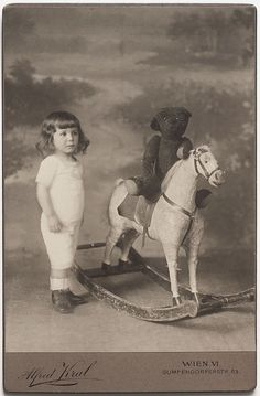 Original Vintage 1913 CC girl with rocking horse and teddy bear