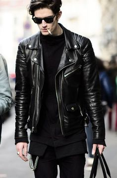 This leather jacket is a wedge shape that makes the persons shoulders look wider while making their hips and waist look smaller.