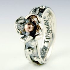 Dogwood Blossom silver ring by Sherry Tinsman at Quirks of Art. Inspired by nature, her home along the Delaware River,  and her English heritage  her pieces feature distinctive patterns and shapes which characterize her work. *Natural elements of the earth and relics of ancient architecture. Pieces are hand fabricated using sterling silver, 14k yellow, or rose gold accents. To add a whimsical elegance, I set some of my pieces with semi-precious stones or pearls. All jewelry 100% handmade…