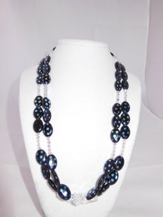 Long necklace of Czech glass oval peacock beads with Swarovski crystals