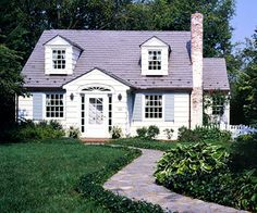 Cottage Style  Cottage Style  Small, informal houses may be called cottages, although historically, cottages could be quite large. They often are sited in garden settings, with window boxes and trellises. Characteristics:    -- Tall, peaked roof  -- Masonry chimney   -- Meandering walkway to the front door   -- Large, multipane windows   -- Wood siding (often shingles)   -- Surrounded by flowers and climbing plants