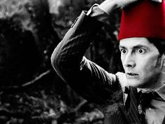 His face is so scared of the fez