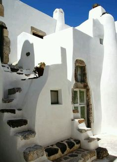 Cycladic architecture - different house styles evolved in different areas of Greece. The Cycladic islands favour flat roof, organic cube shapes
