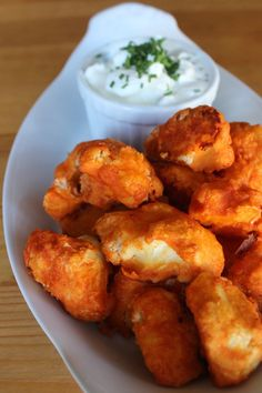 """Pin for Later: 38 Healthy Party Appetizers to Celebrate the Oscars Crispy Cauliflower Buffalo Wings Crispy on the outside yet soft on the inside, these cauliflower bites are the closest a vegetarian gets to a """"real"""" buffalo wing experience. Low Carb Recipes, Vegetarian Recipes, Cooking Recipes, Thai Recipes, Coliflour Recipes, Vegetarian Wings, Recipies, Cauliflower Recipes, Buffalo Cauliflower Bites"""