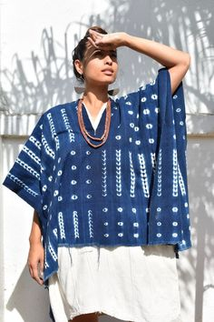 Shibori indigo poncho with Vintage African fabrics by Mira Blackman #slowfashion #boholuxe #slowfashionmovement #sacredadornment #mudcloth #boho #bohochicstyle #mudcloth