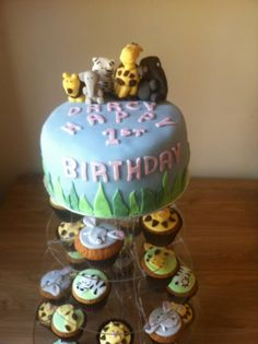 First birthday cake - chocolate cake with vanilla cupcakes and edible animal toppers