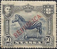 """Nyassa 1921: Nyassa was a part of the former Portuguese colony of Mozambique. A picture of King Manuel II, the last king of Portugal, is in the corner. Manuel was king from 1 February 1908 to 5 October 1910. The stamps were overprinted """"Republica"""" when issued in 1911.  With the advent of new Portuguese currency on 22 May 1911, the real had become obsolete. In 1921 the stamps were surcharged with new values. This 50 reis stamp was overprinted """"5 Centavos."""""""