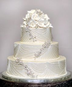 White side detail and handmade crystals. Perfect. By Konditor Meister Elegant Wedding Cakes