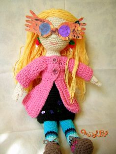This is almost enough to make me sit down and finish teaching myself how to crochet.  Almost. -Luna Lovegood Amigurumi by Mishto