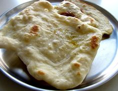 Naan on tawa or tawa naan recipe. Easy step by step recipe to make tawa naan on the stove top on an regular pan called tawa in India.
