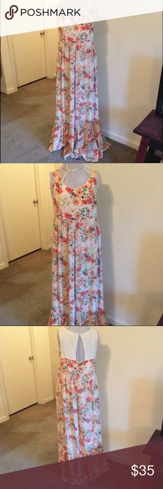 """Lauren Conrad Floral and Lace Maxi Dress Beautiful flowing Floral and Lace maxi dress with keyhole on back. Size 14. Side zipper. 100% Rayon. 18"""" armpit to armpit (laying flat), 59.5"""" shoulder to hem, 17"""" waist (laying flat). LC Lauren Conrad Dresses Maxi"""