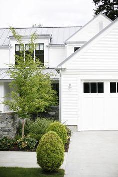 White modern farm house + grey metal roof