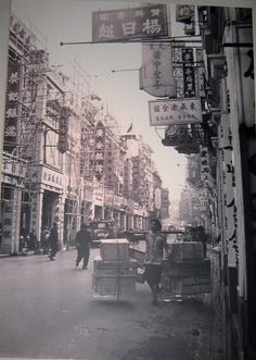Street scene from the late 1940s, Hong Kong History Museum * 1500 free paper dolls and toys Chinese paper dolls at The China Adventures of Arielle Gabriel, also free Chinese toys at Arielle Gabriels The Internaitonal Paper Doll Society *