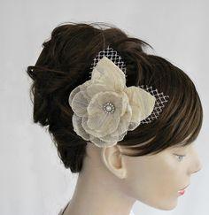 Weddings hair flower ivory cream bridal head piece handmade unique design. $36.00, via Etsy.