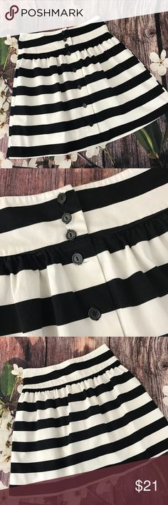 """Lovely Day Skirt This Skirt button up the front and is a nice thick material.  Perfect paired with a black top and boots. In great condition.  📐Measurements & Information 📐  Waist approx 28"""" Length Approx 18"""" Waist band Approx 3.25"""" Lovely Day Skirts"""