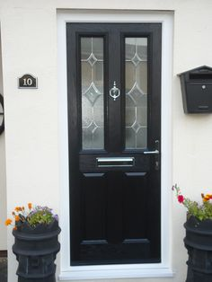 Midnight black composite front door by COVE Windows! Black Composite Front Door, Back Doors, Entrance Doors, House Front, Garden Styles, China Cabinet, Tall Cabinet Storage, Garden Design, New Homes