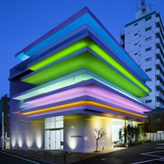 Horizontal layers of colour protrude out from the facade of this bank branch in Tokyo