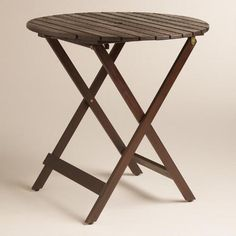 One of my favorite discoveries at WorldMarket.com: Round Espresso Wood Mika Folding Dining Table