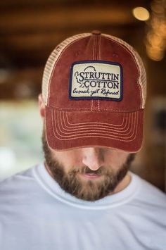 The one of a kind Struttin' Cotton logo on an awesome hat Decorated right here in the USA. Weathered, printed patch and faded cap creates a vintage look. Hat is adjustable. Mesh is super soft and bill