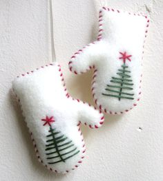 I like the simple embroidered Christmas tree with star on these. Mittens Christmas ornament in white felt  by MakeCreateNYC on Etsy, $8.00 Felt Christmas Decorations, Christmas Ornaments To Make, Christmas Sewing, Noel Christmas, Homemade Christmas, Felt Crafts, Holiday Crafts, Simple Christmas, Fabric Ornaments