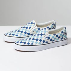 The Checkerboard Classic Slip-On features sturdy low profile slip-on canvas  uppers made with the iconic Vans checkerboard print 7a943db36