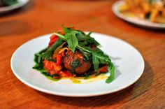 Niman Ranch lamb meatballs with roasted tomatoes, sweet peppers, green olives, and pickled chilis at Rustic Canyon